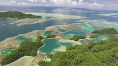 Aerial drone shot of coral reef, basins, rock islands, marine lakes and submerged river channel in Palau