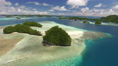 Aerial shot over Rock Islands, coral reef and beach in Palau