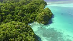 Aerial view of secluded bay in tropical setting