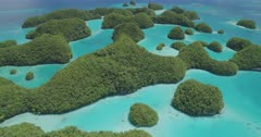 Aerial shot flying low over Palau's 70 islands