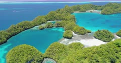 Ascending aerial shot of Ulong Island in Palau