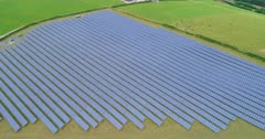 Aerial shot of solar farm in the UK (part of a sequence)