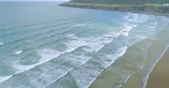 Aerial shot of beach on Atlantic Ocean with Kite Boarders in surf
