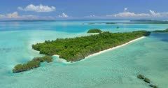 Ascending and reversing aerial shot of Ngemelis island and UNESCO World Heritage site in Republic of Palau