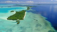 High tracking aerial shot of Ngemelis island and UNESCO World Heritage site in Republic of Palau