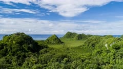 Aerial hyperlapse over mangrove forest and hills in tropical coastal Palau