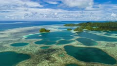 Aerial hyper lapse over coral reefs and islands in Palau