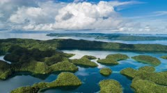 Aerial Hyper lapse ascending over Ngermid Bay in Palau at sunrise with calm water