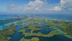 Aerial hyper lapse flying over tropical islands towards Koror town in Palau