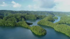 Aerial tracking shot over tropical islands in Ngermid Bay, Palau