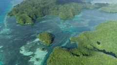 Aerial tracking shot over the main tidal channel into Ngermid Bay, Palau.