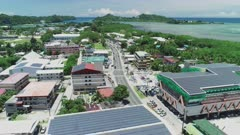 Aerial shot flying over downtown Koror in Palau