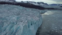Aerial view along the edge of a glacier, in East Greenland