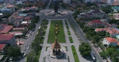 Drone footage of the Independence Monument in the city center. The camera is going towards the monument following the Preah Sihanouk Blvd (274) and the Preah Suramarit Blvd (268) and goes over the Statue of King Father Norodom Sihanouk.