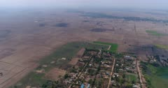 Drone footage of the north part of Battambang. The camera is very high over Ek Phnom Temple and is doing a 360 degrees panning swowing the countryside of the northern area of Battambang and its rice fileds already harvested at that time of the year.