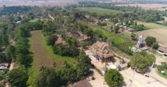 Drone footage of the north part of Battambang. The camera is going over the Ek Phnom area starting at the Pagoda and Buddha statue side and finishing over the old temple.