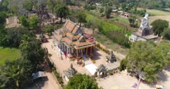 Drone footage of the north part of Battambang. The camera is going over the Ek Phnom area starting in front of the Pagoda and going sideways passing the Buddha statue to finish on the side of the old temple.