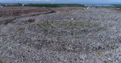 Drone footage of the main official rubbish dump in Bali. A 30 hectares pile of waste (including plastic, organic, glass, furniture and more) that goes up to 20m high. The camera is going sideways showing the few meters stairs like piles of trash.