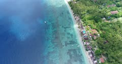 Drone footage of the algae plantation in the shallow reef of the northern part of Nusa Penida. The camera is facing down and is going over the shallow water along the coast.