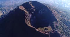 Aerial footage of the Batur volcano crater. The camera is panning along the crater.