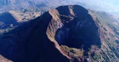 Aerial footage of the Batur volcano crater. The camera is going sideway.