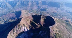 Aerial footage of the Batur volcano crater. The camera is going towards the crater while tilting down.
