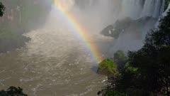 Iguazu Falls lower cataract and rainbow in mists