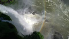 Pan up lower falls rainbow to Devil's Throat canyon