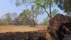Move left along wall surrounding Koh Ker Pyramid