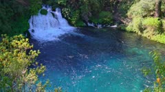 Waterfal in turquoise pool