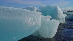 Beached icebergs and flowing water