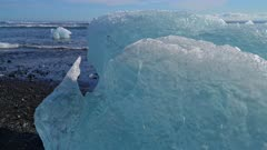 Beached icebergs and lapping waves