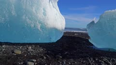 Beached icebergs on rocky shore