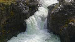 Pan up cascading waterfall