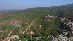 Aerial fly backward along Mount Popa end to end