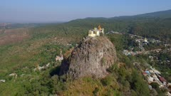 Aerial fly forward along Mount Popa end to end