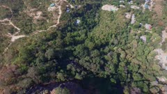 Aerial fly backward over Mount Popa looking down