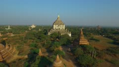 Aerial vertical descent medium temple with large white temple in background