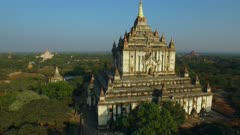 Aerial vertical climb of large white temple