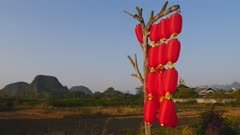 Red Lanterns in a shoreline Li River village