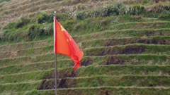 Chinese Flag flying above a rice terrace