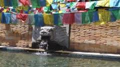 Buddhist Prayer Flags at a fountain