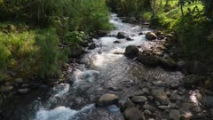 Rushing mountain stream in volcanic highlands