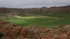Sunlight moves across mountainous Mongolian Steppes