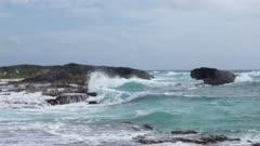 water waves splashing and crashing against rocks
