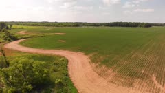countryside with dirt road and fields. Aerial view. Summer landscape.