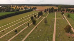 Aerial view of tranquil cemetery in a countryside.