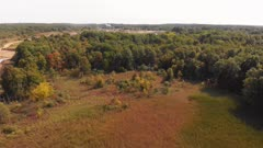 Beautiful autumn trees and mine processing facility in the background. Aerial view.