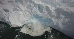 Aerial view of ice calving from glacier in Antarctica
