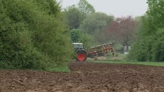 tractor turns at edge of field and starts plowing